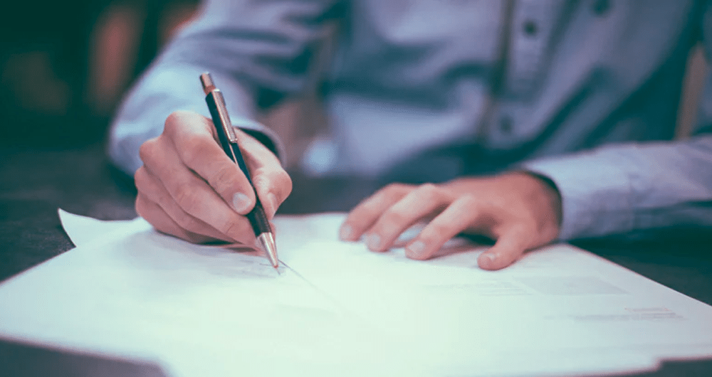 estate planning - person signing legal documents