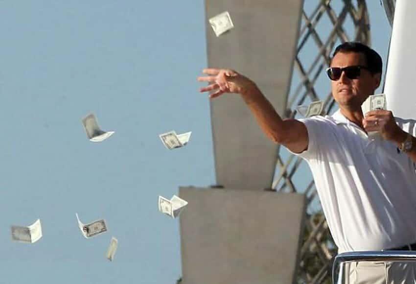 Jordan Belfort throwing money in The Wolf of Wall Street