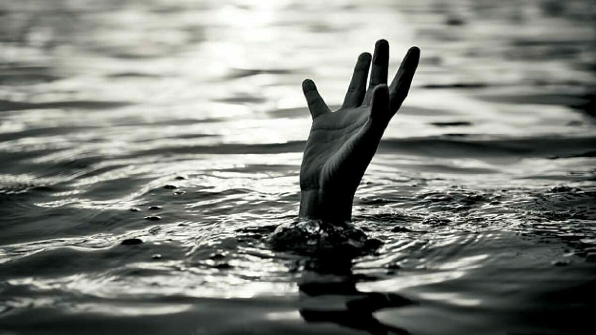 A drowning person reaching out their hand for help.