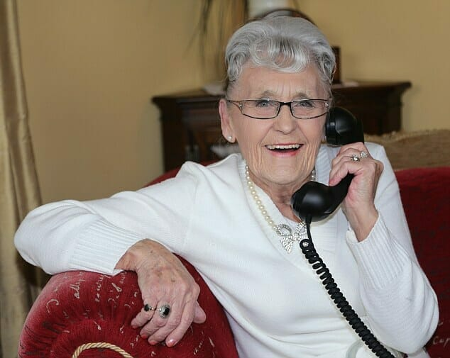 Granny using a home phone.