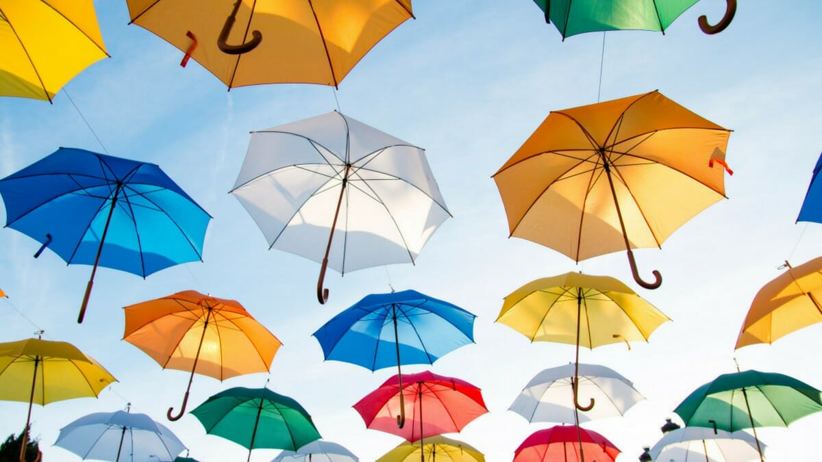 A bunch of open umbrellas in different colors