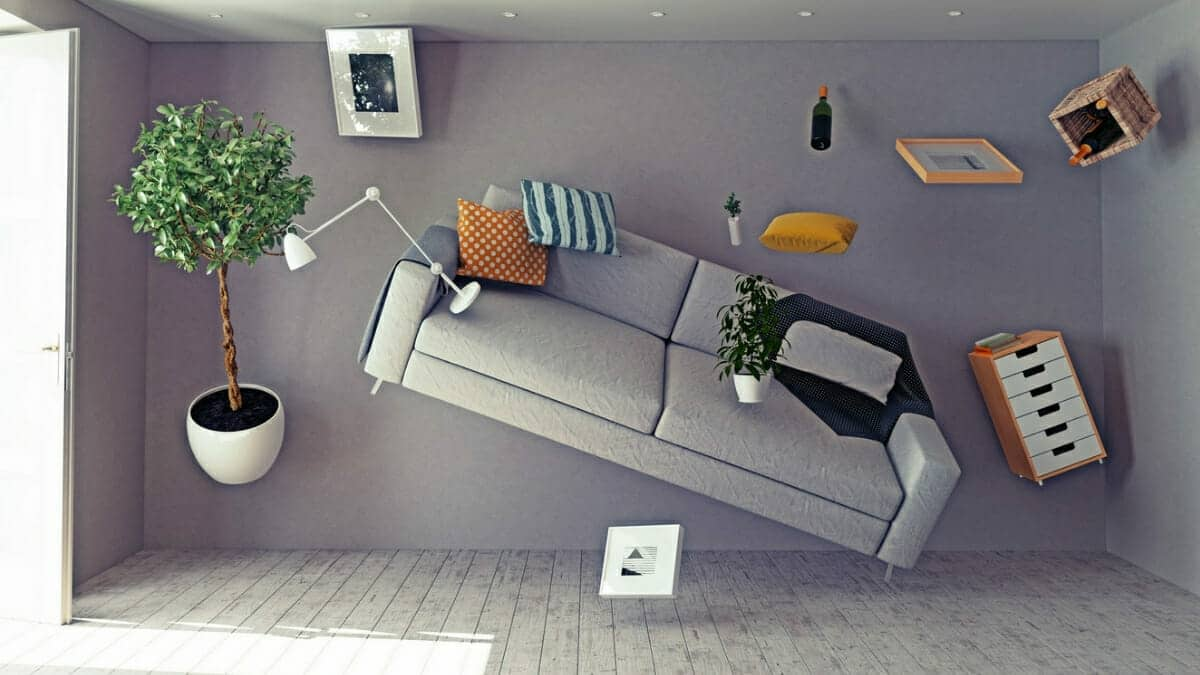 Room with furniture and objects flying in the air