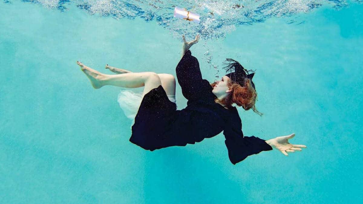 Graduate sinking underwater