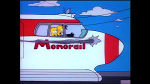 Homer and Bart on the monorail as it goes out of control.