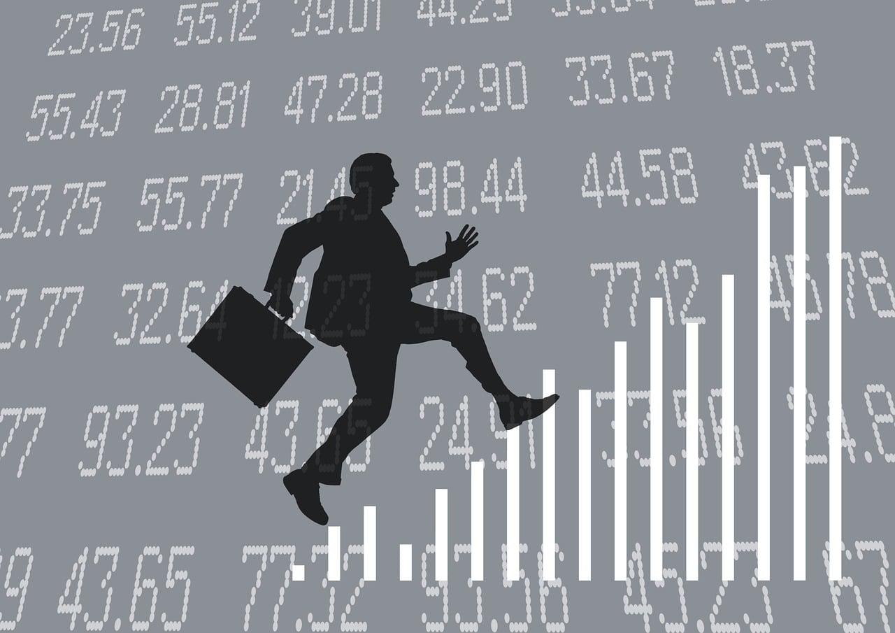 entrepreneur with briefcase climbing