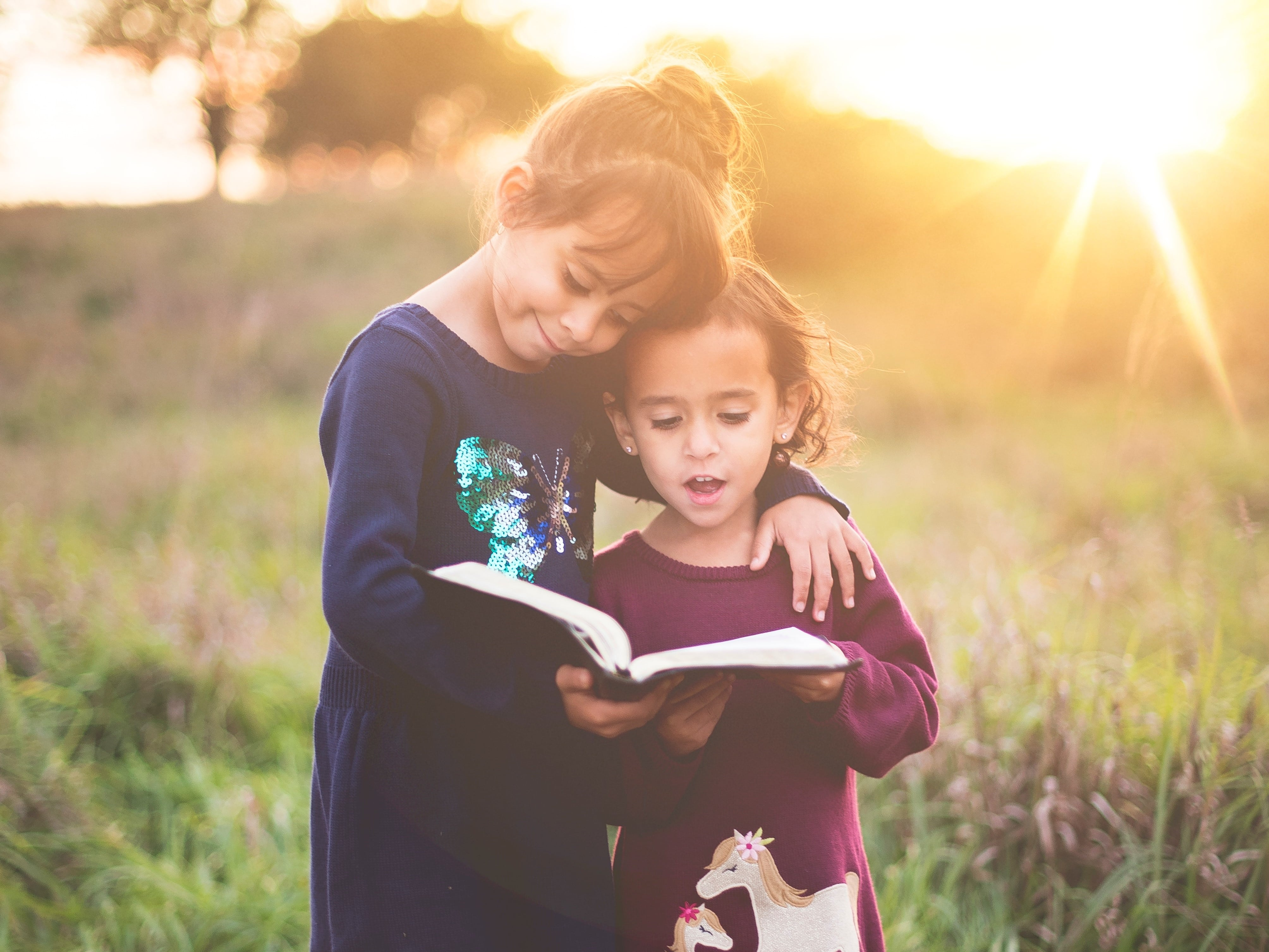 Two kids reading together.