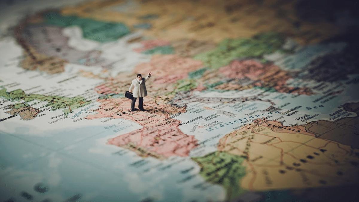 businessman figure standing on globe