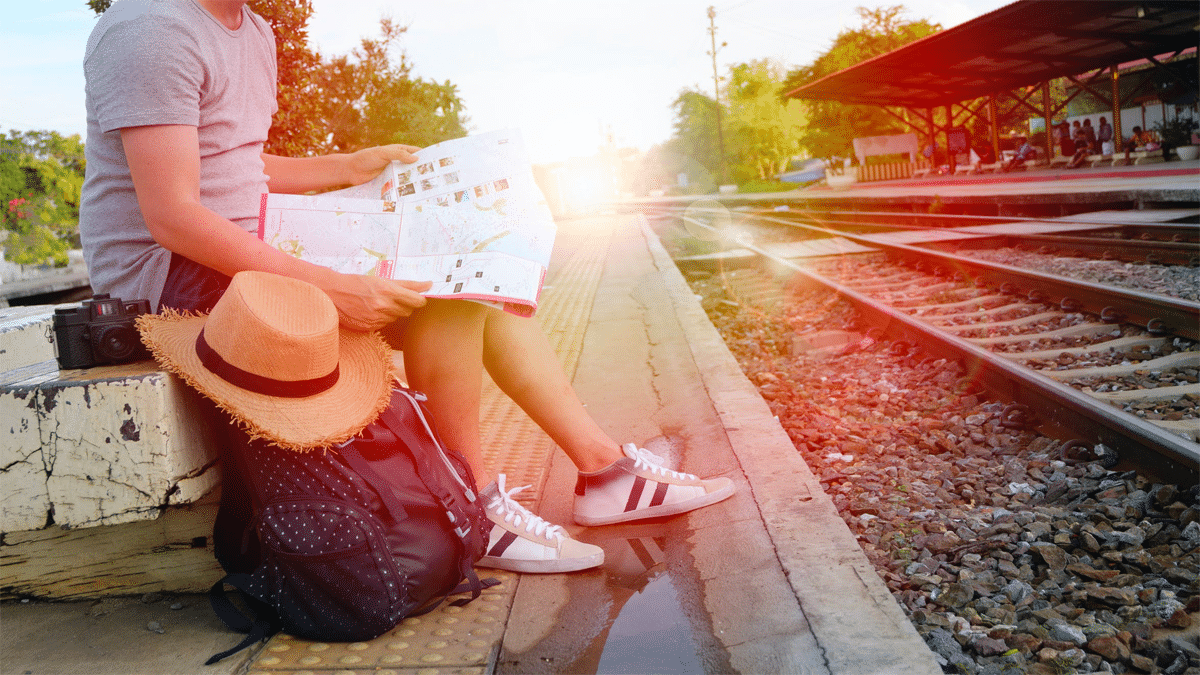 traveler at train tracks