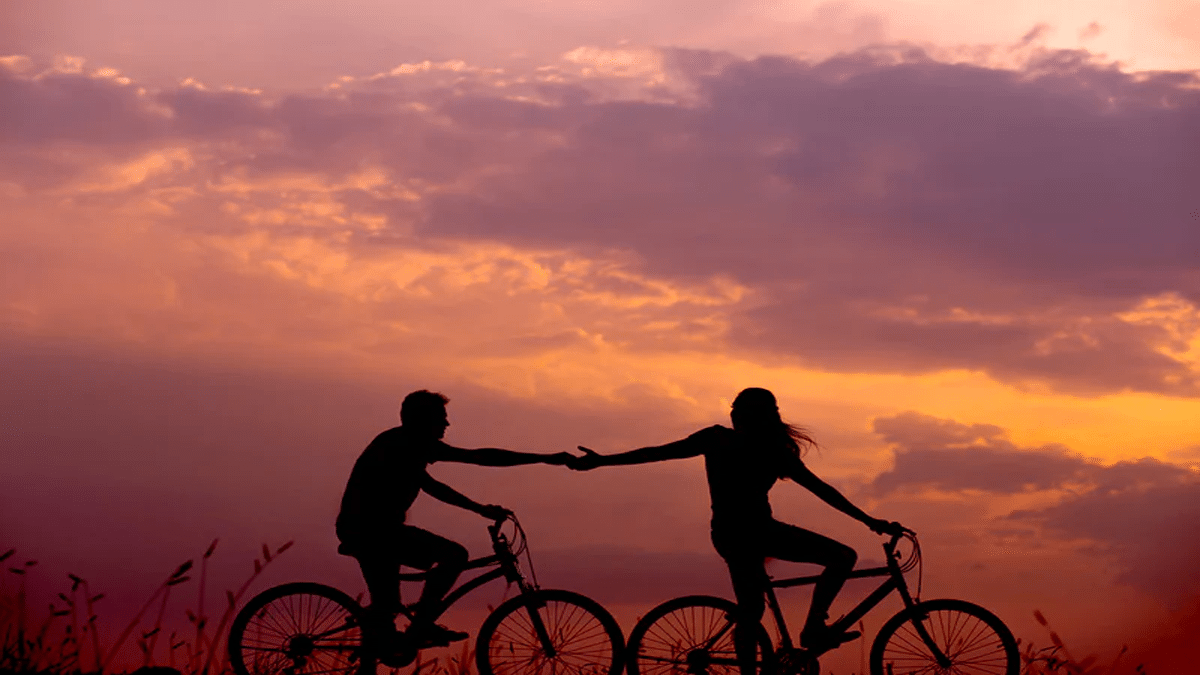 bicyclists at sunset