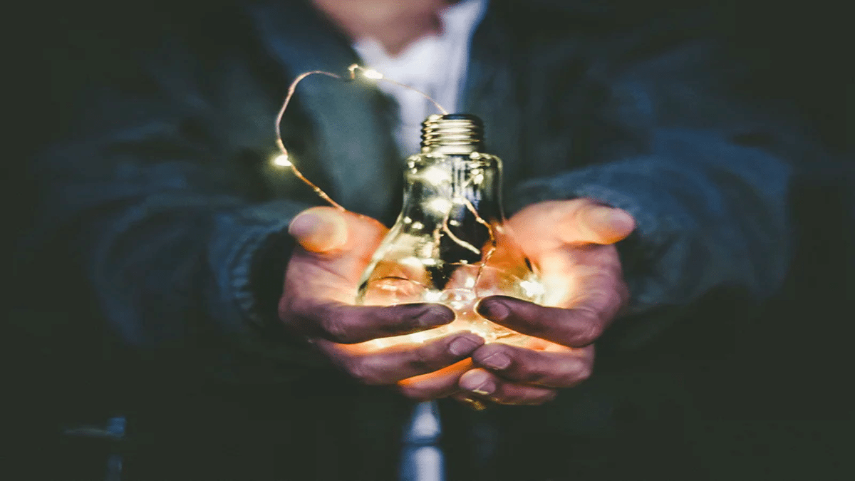 hands holding lightbulb